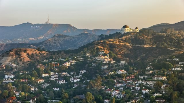 Aerial view of Griffith Observatory with the Hollywood Sign seen in the distance
