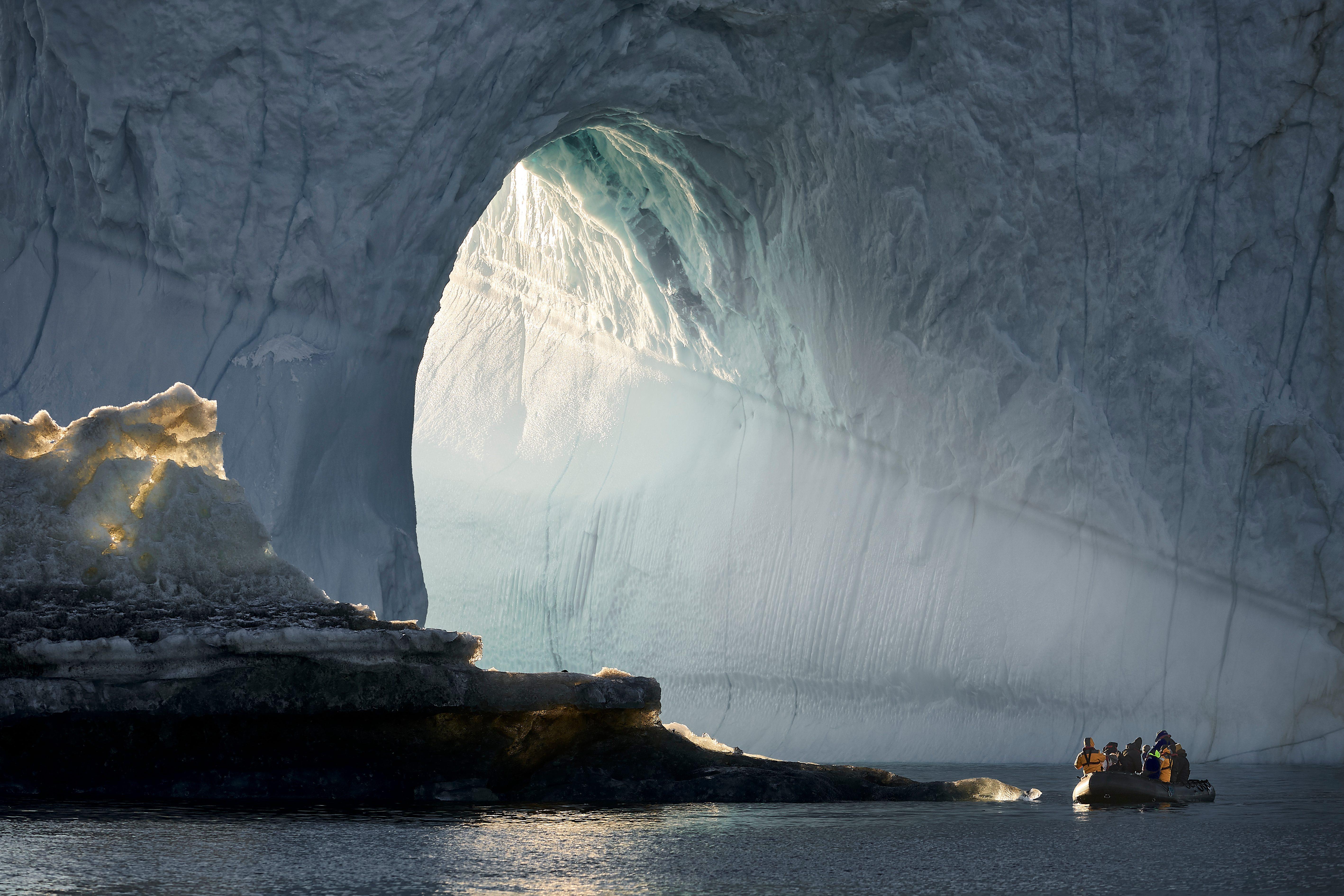 Exploring icebergs, Scoresbysund, Greenland