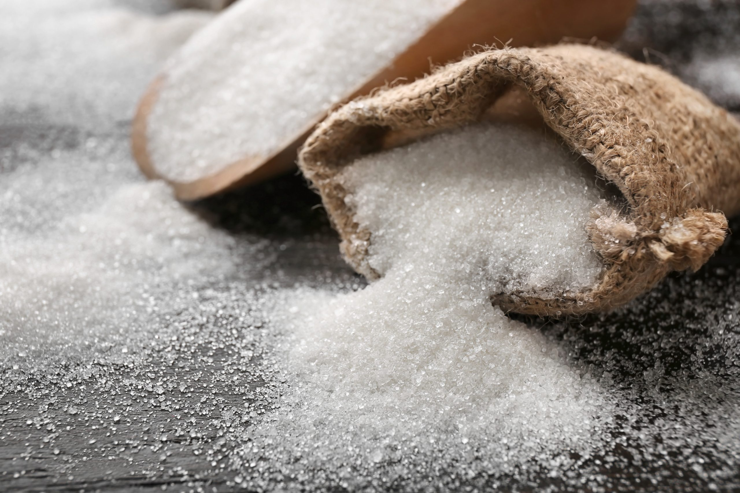 Sack with pure sugar on table