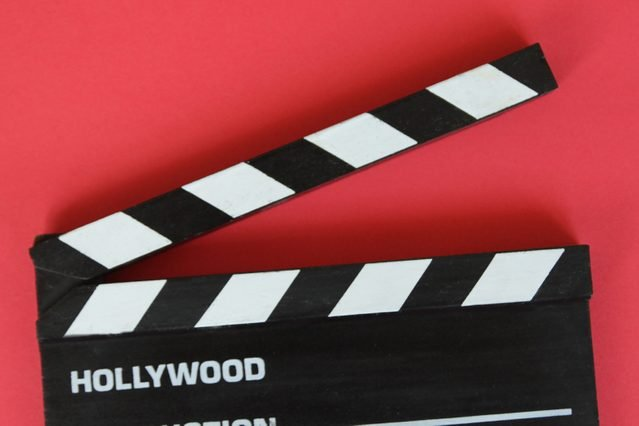 Filmmaker's Clapboard On Red Background.