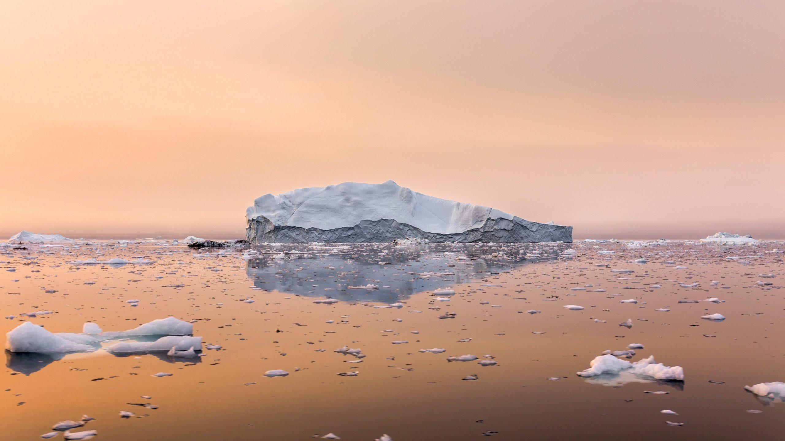 Iceberg on beautiful sea in the sunset