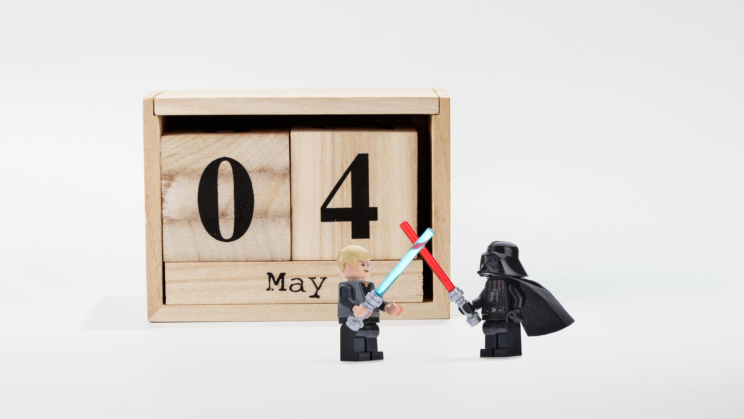 perpetual calendar May 04 and star wars lego figurines on gray background