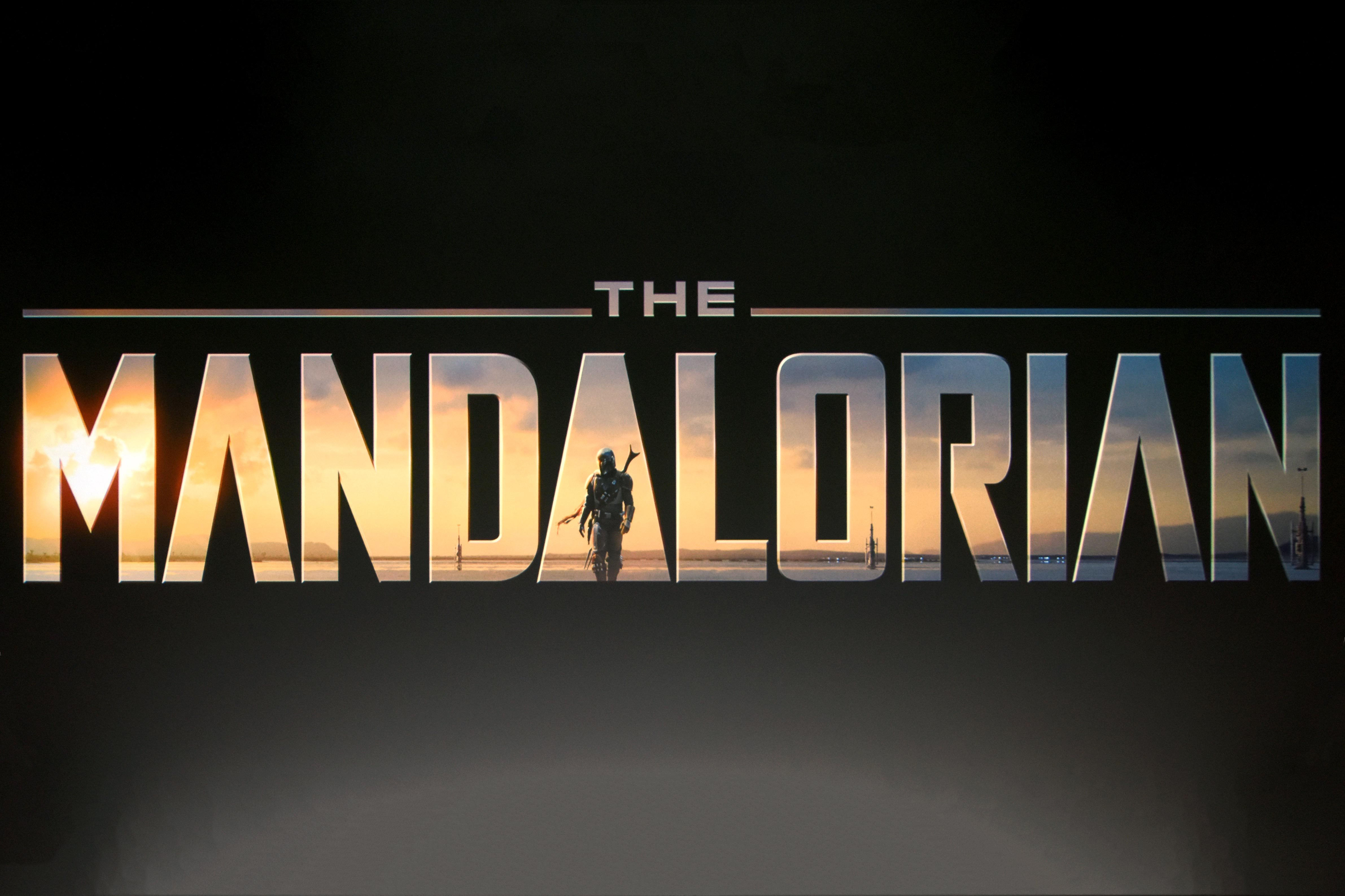 the mandalorian logo projected on a big screen