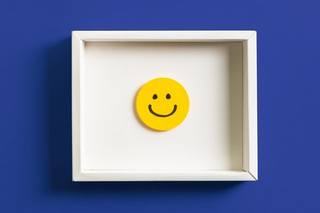 happy face in a frame. dark blue background