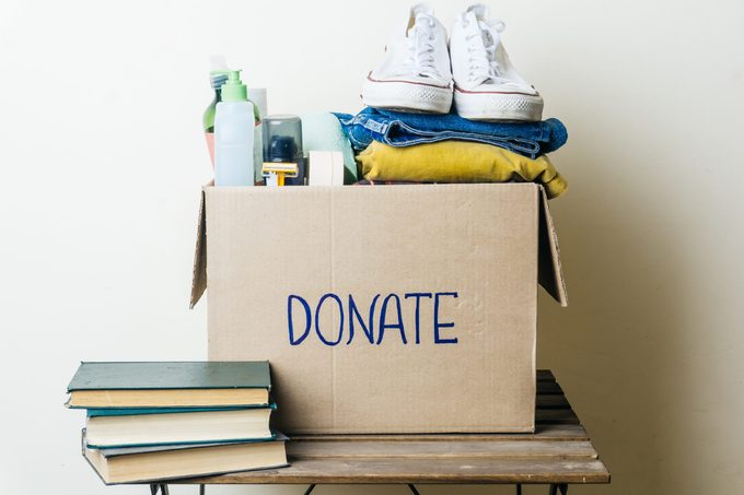 CLOTHES DONATION AND FOOD DONATION CONCEPT. Donation box with clothes and hygiene products.