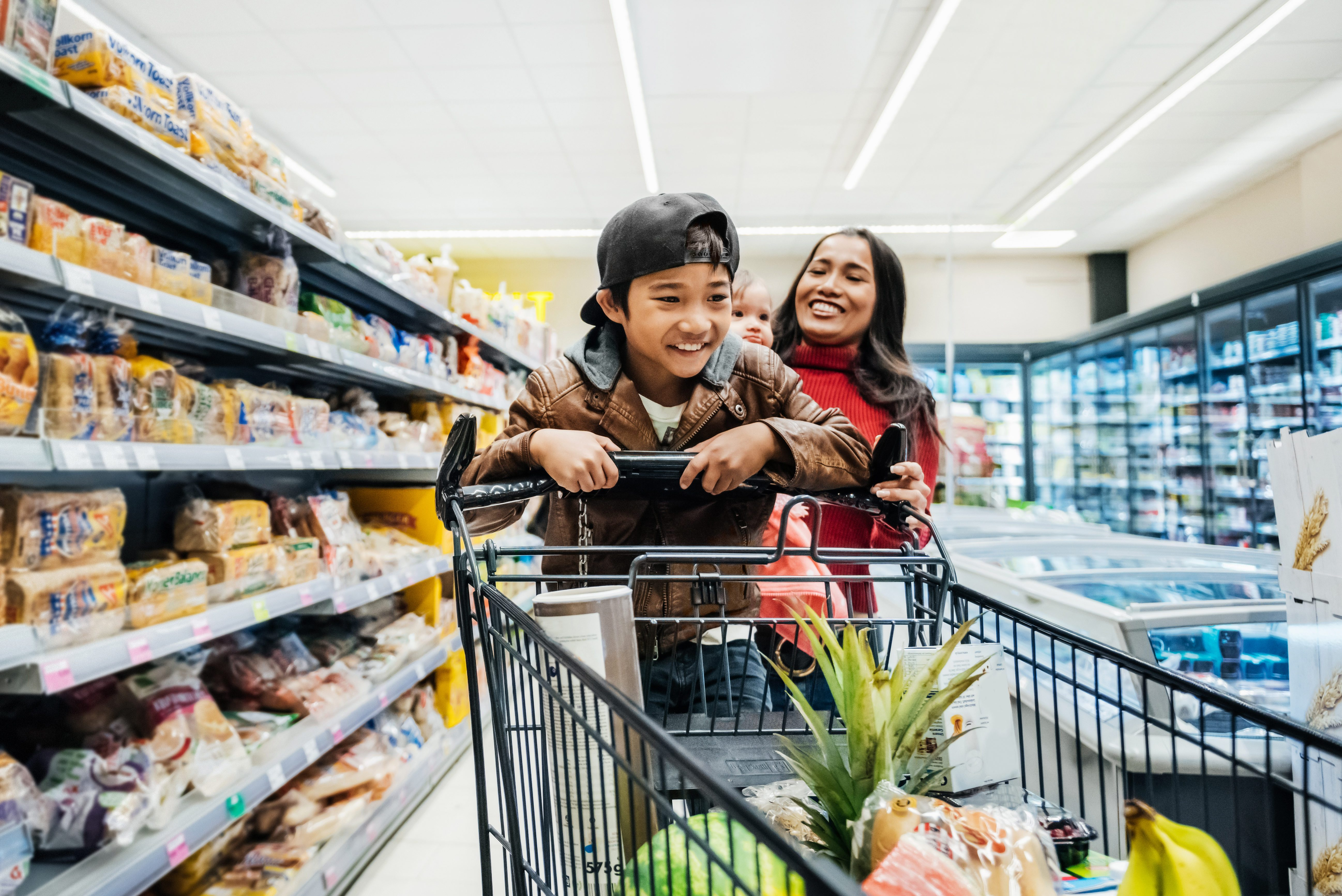 Family Having Fun While Out Buying Groceries.