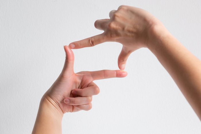 symbol of camera frame by using thumb and forefinger of two hands.