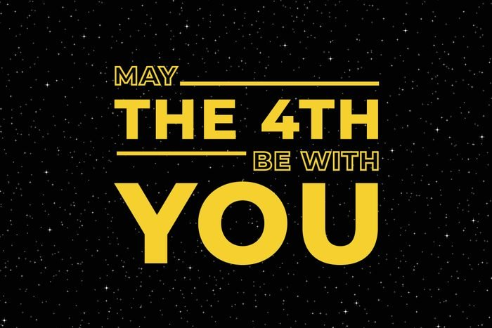 """""""may the 4th be with you"""" in yellow letters on a black, starry sky background"""