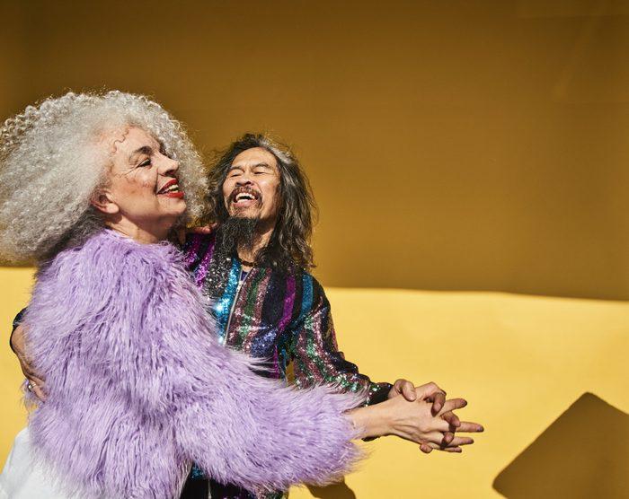 Colourful studio portrait of a senior man and woman
