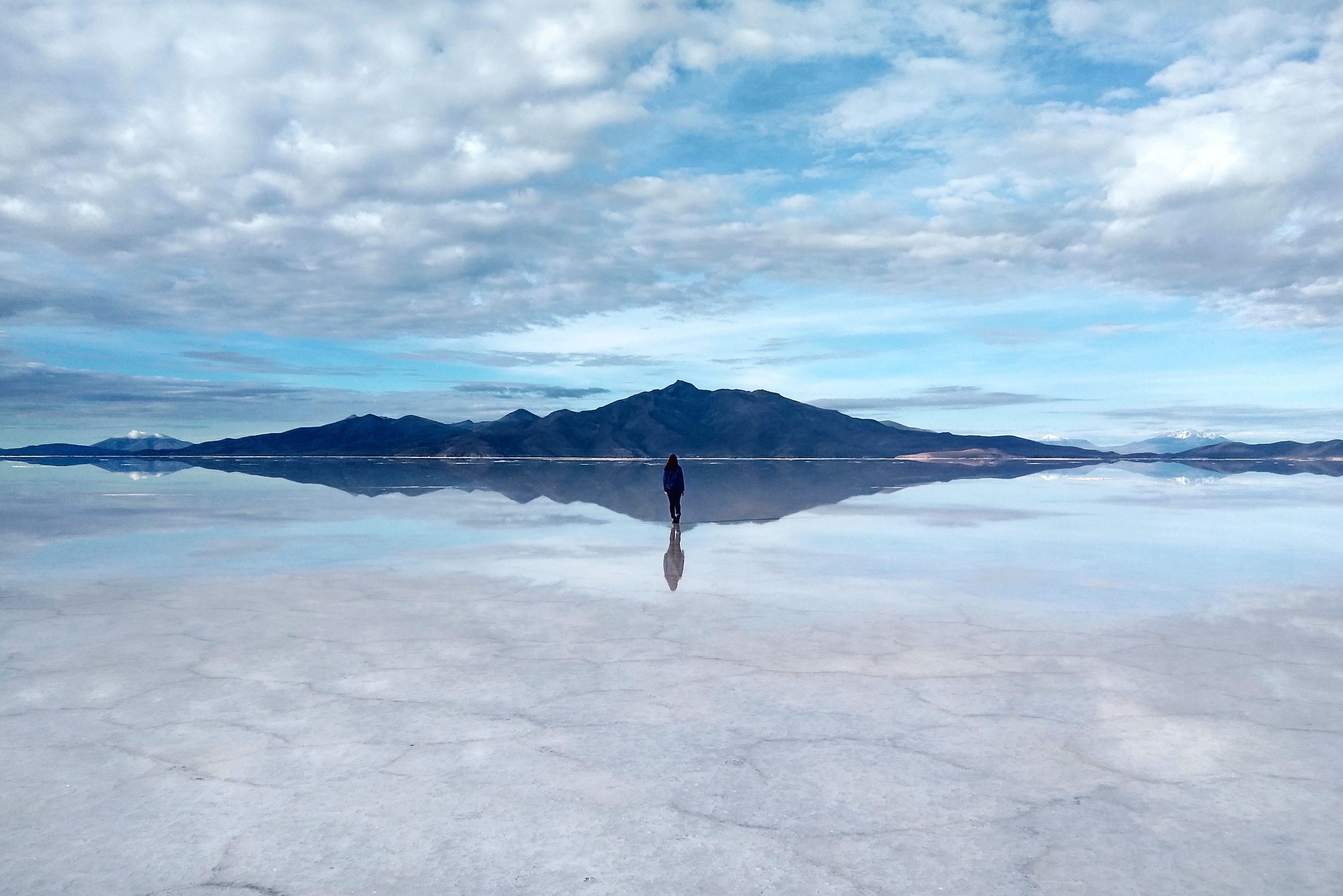 Woman walking in Salar de Uyuni, Bolivia.