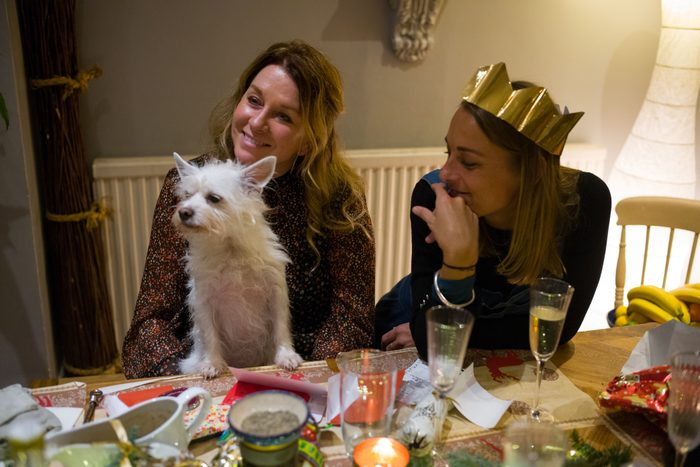 Family At Christmas Table with A Dog