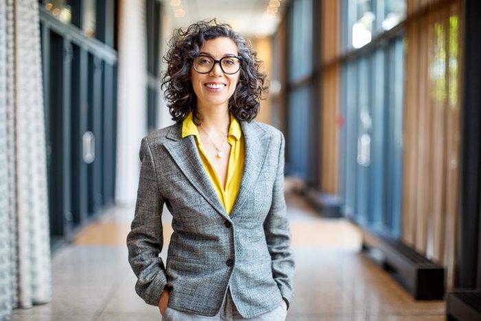 Smiling female entrepreneur outside auditorium