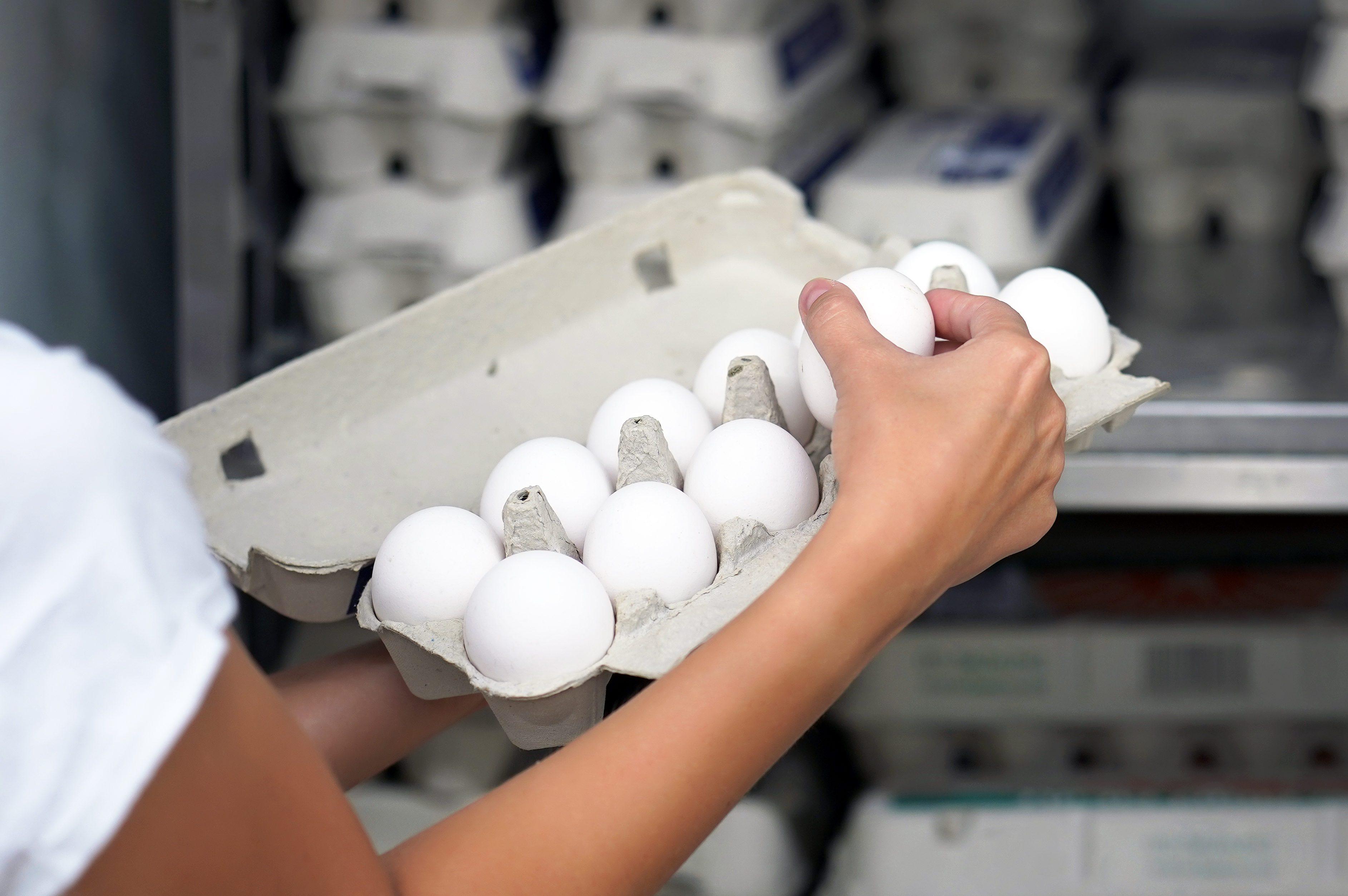 Woman buys eggs
