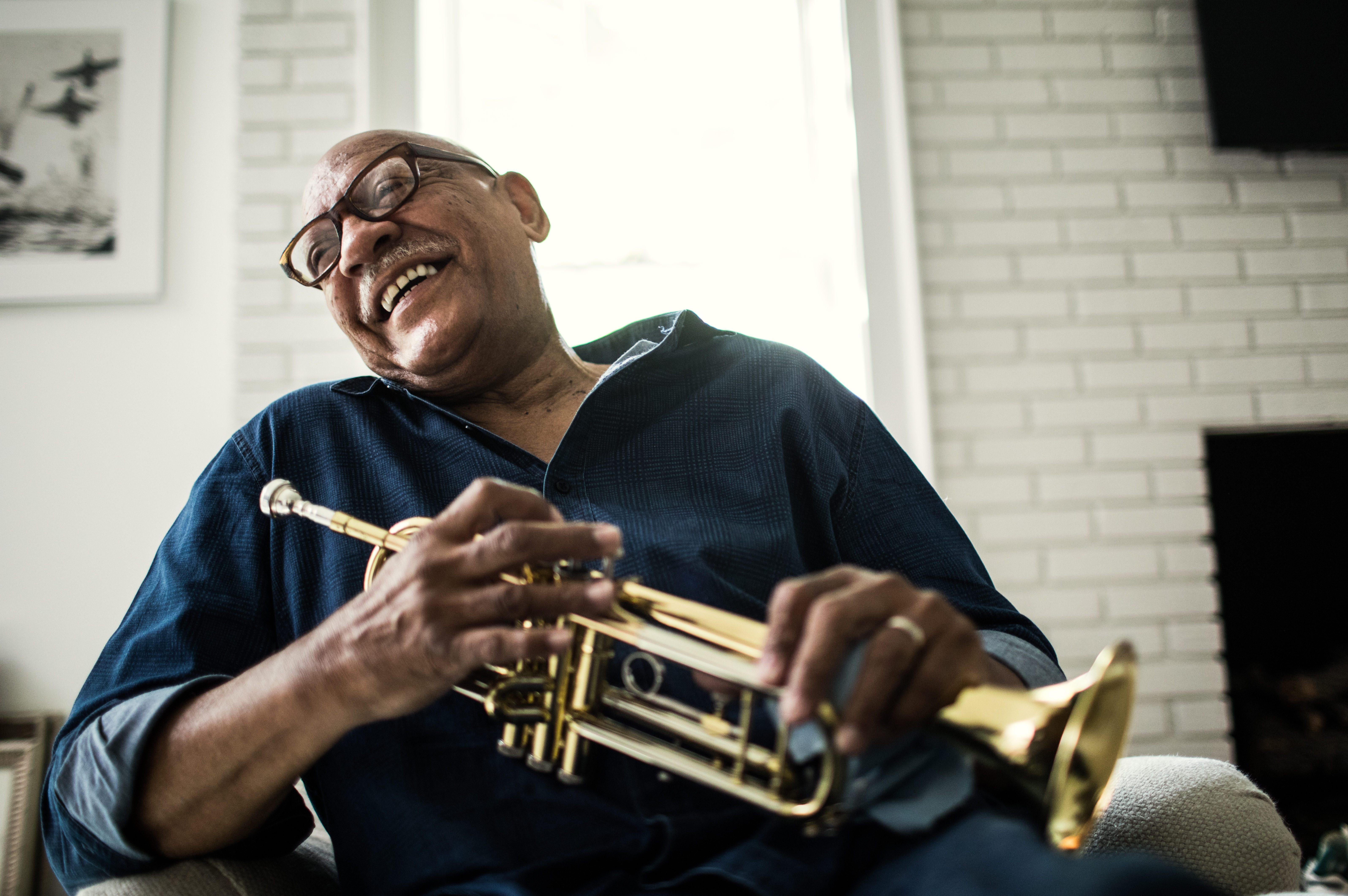 Portrait of senior man with trumpet