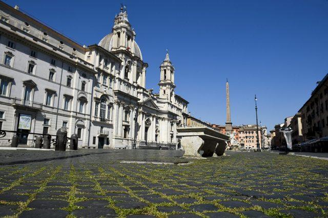 Unusual grass grows through the cobblestones in Piazza...