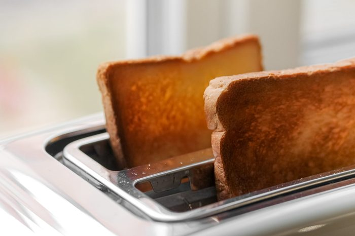 Toaster with ready bread slices in the kitchen. traditional breakfast at home