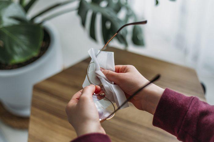 Woman Cleaning Eyeglasses