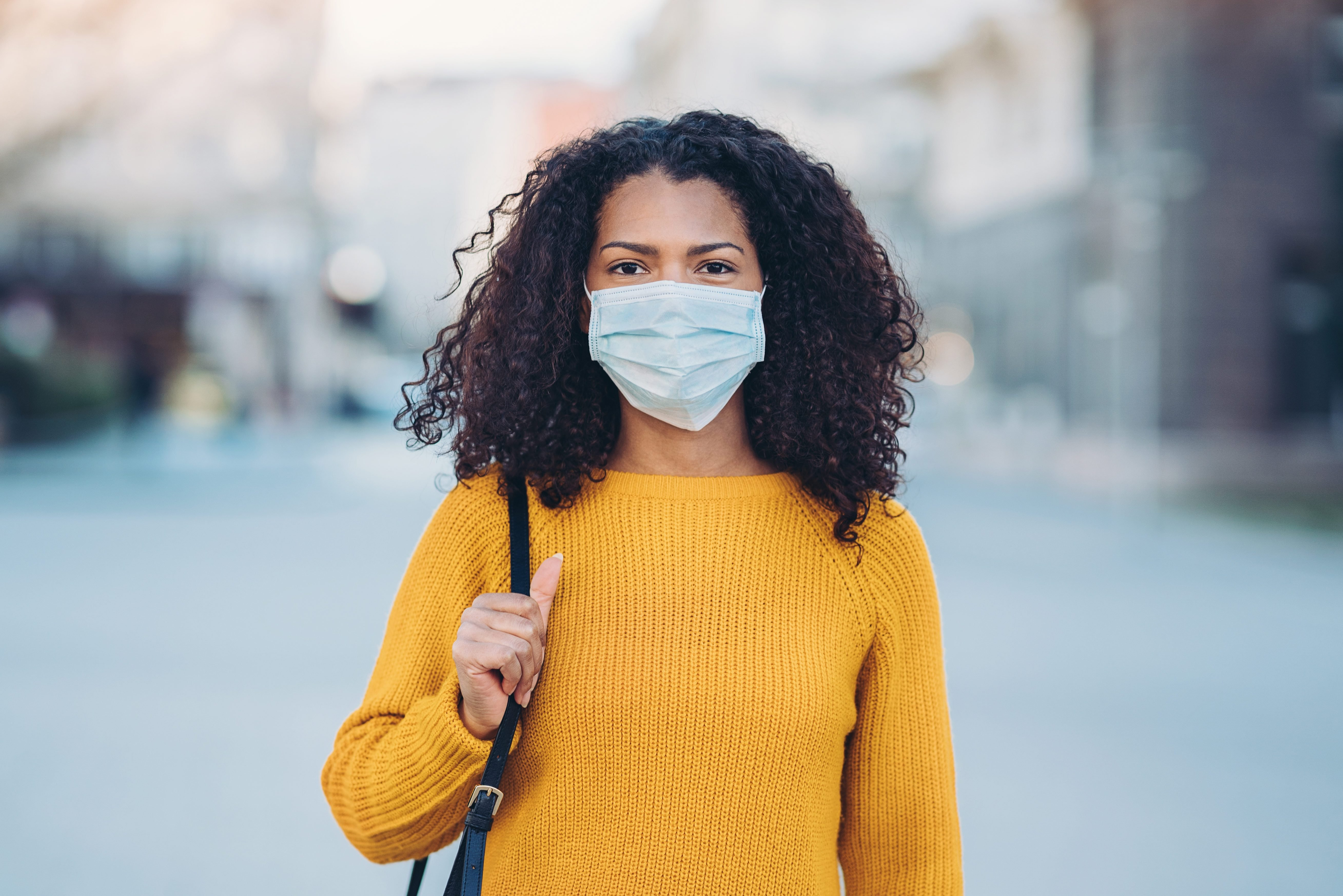 Young woman with a mask during pandemic