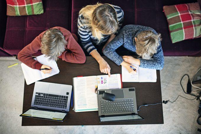 Mother homeschooling her children