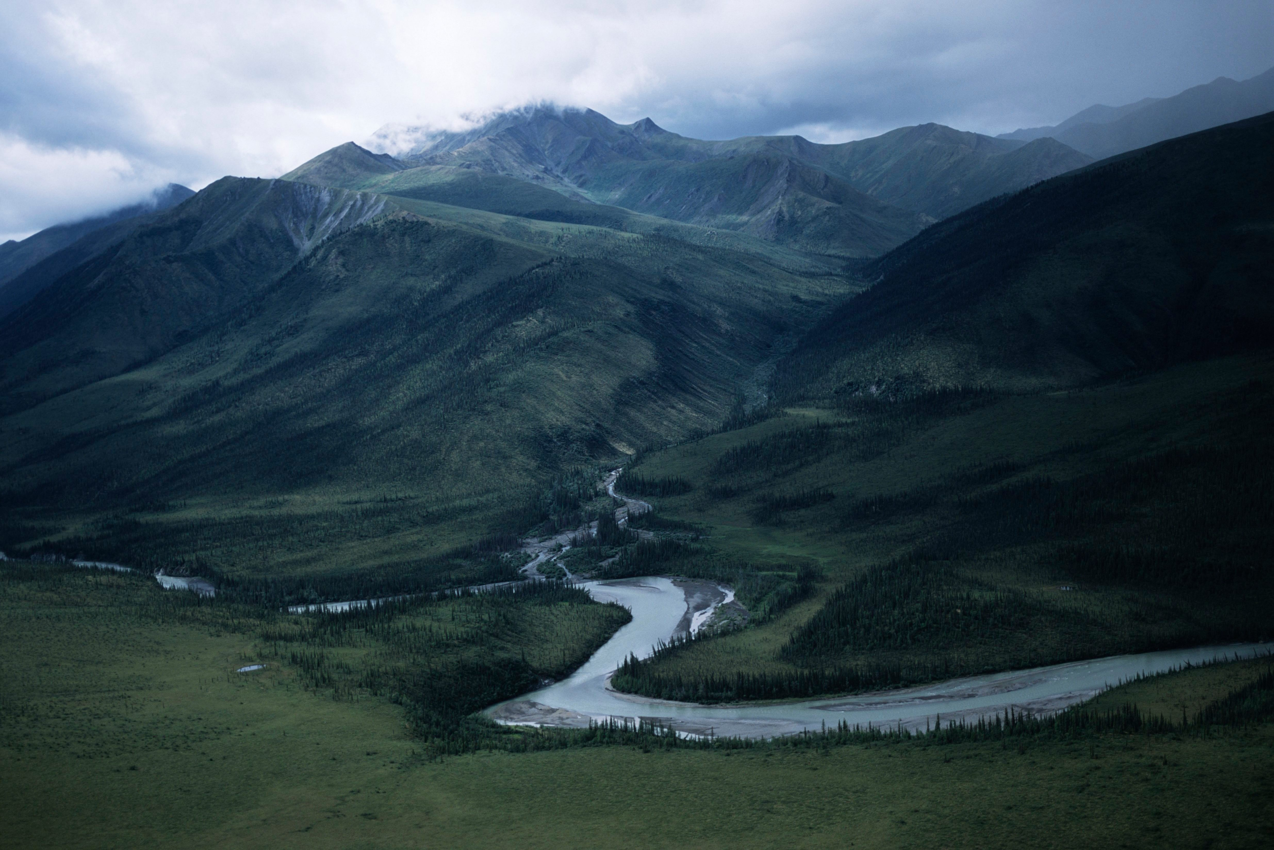 USA, Alaska, Gates of the Arctic National Park, river valley with mountains in background
