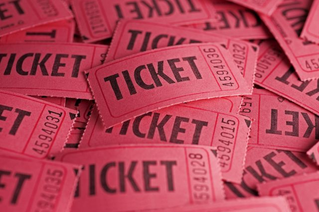 Red raffle tickets scattered and piled up on one another