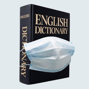 dictionary wearing a surgical mask. concept.