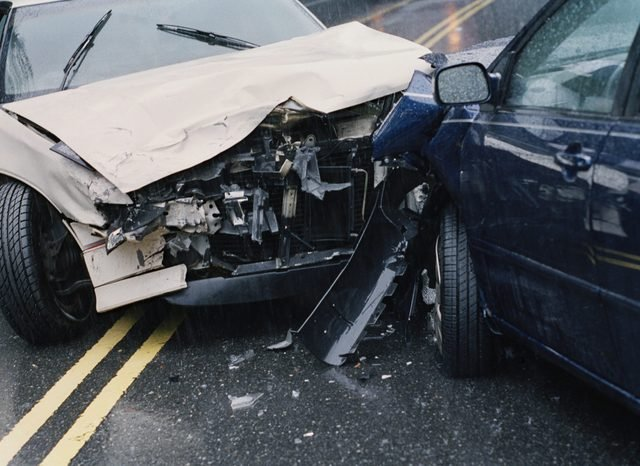 Two damaged cars after crash, close-up