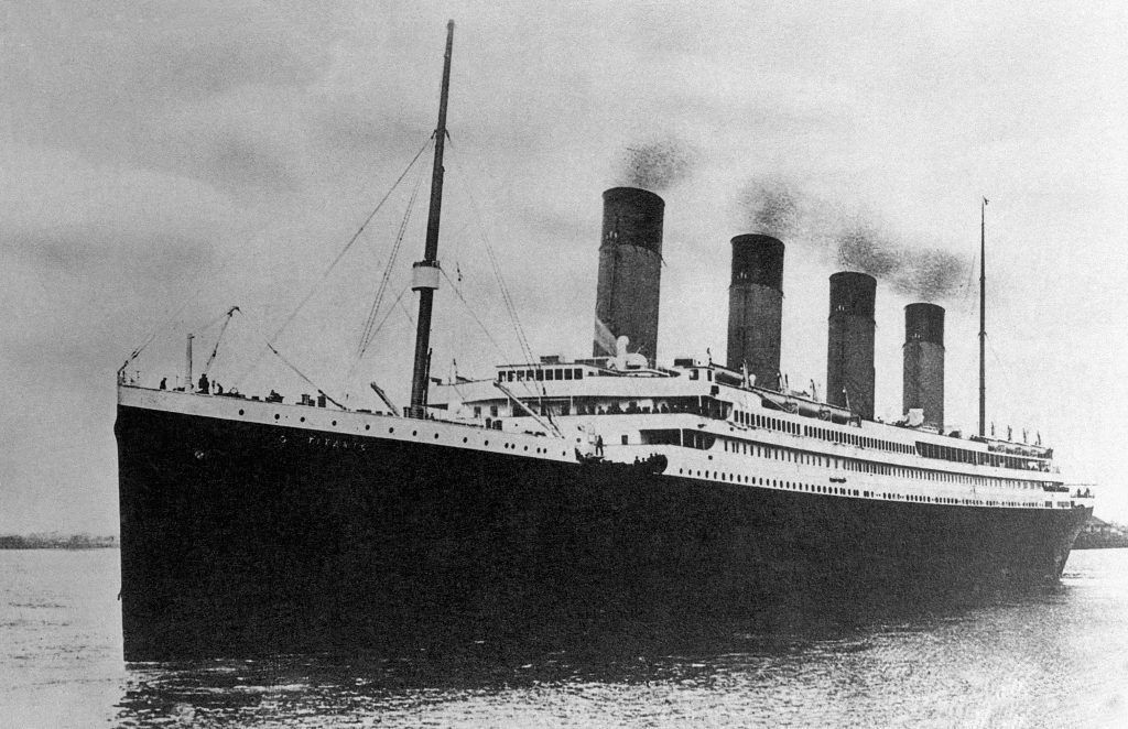 The White Star Line passenger liner R.M.S. Titanic embarking on its ill-fated maiden voyage.