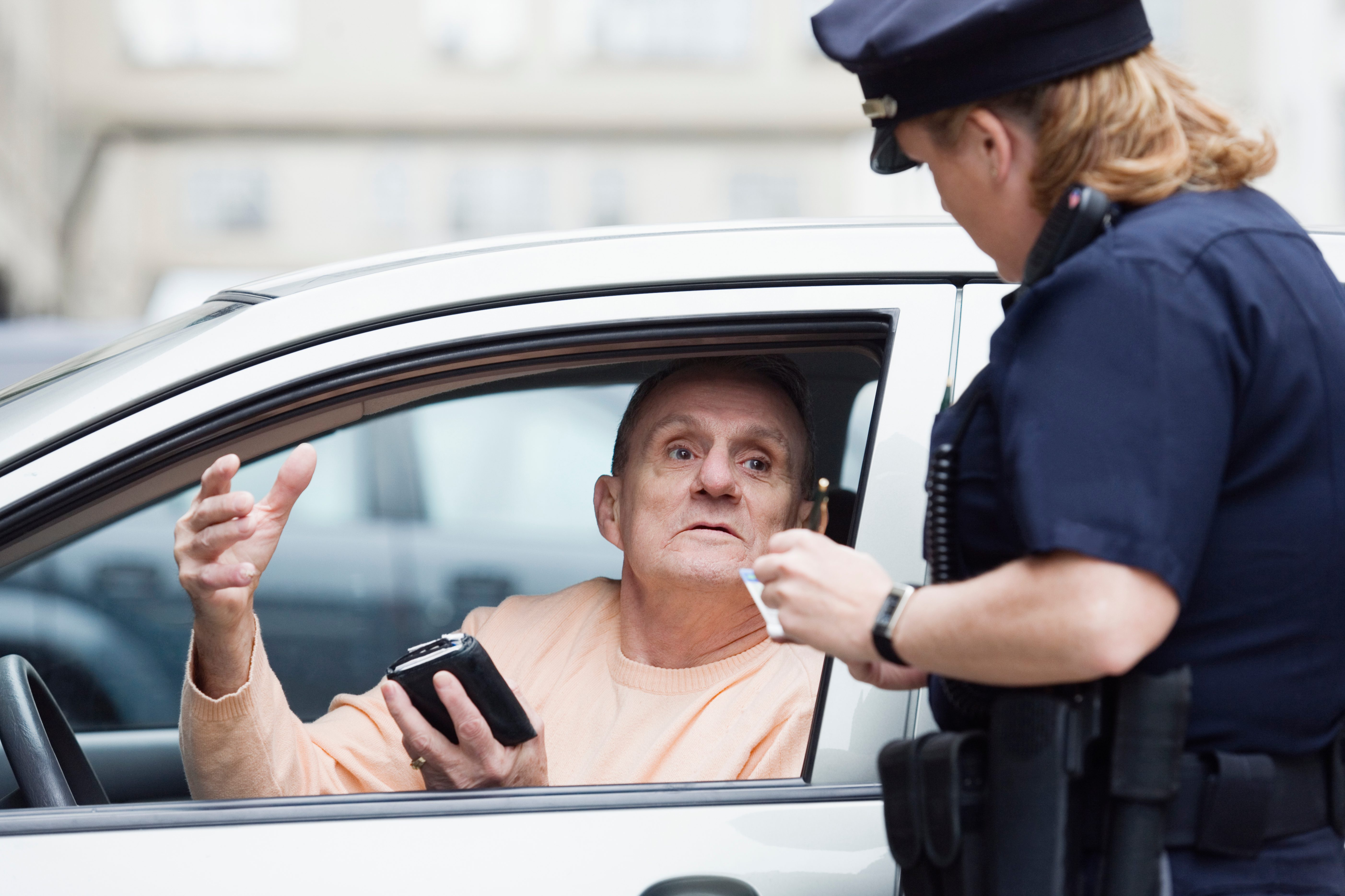 Policewoman interrogating a man