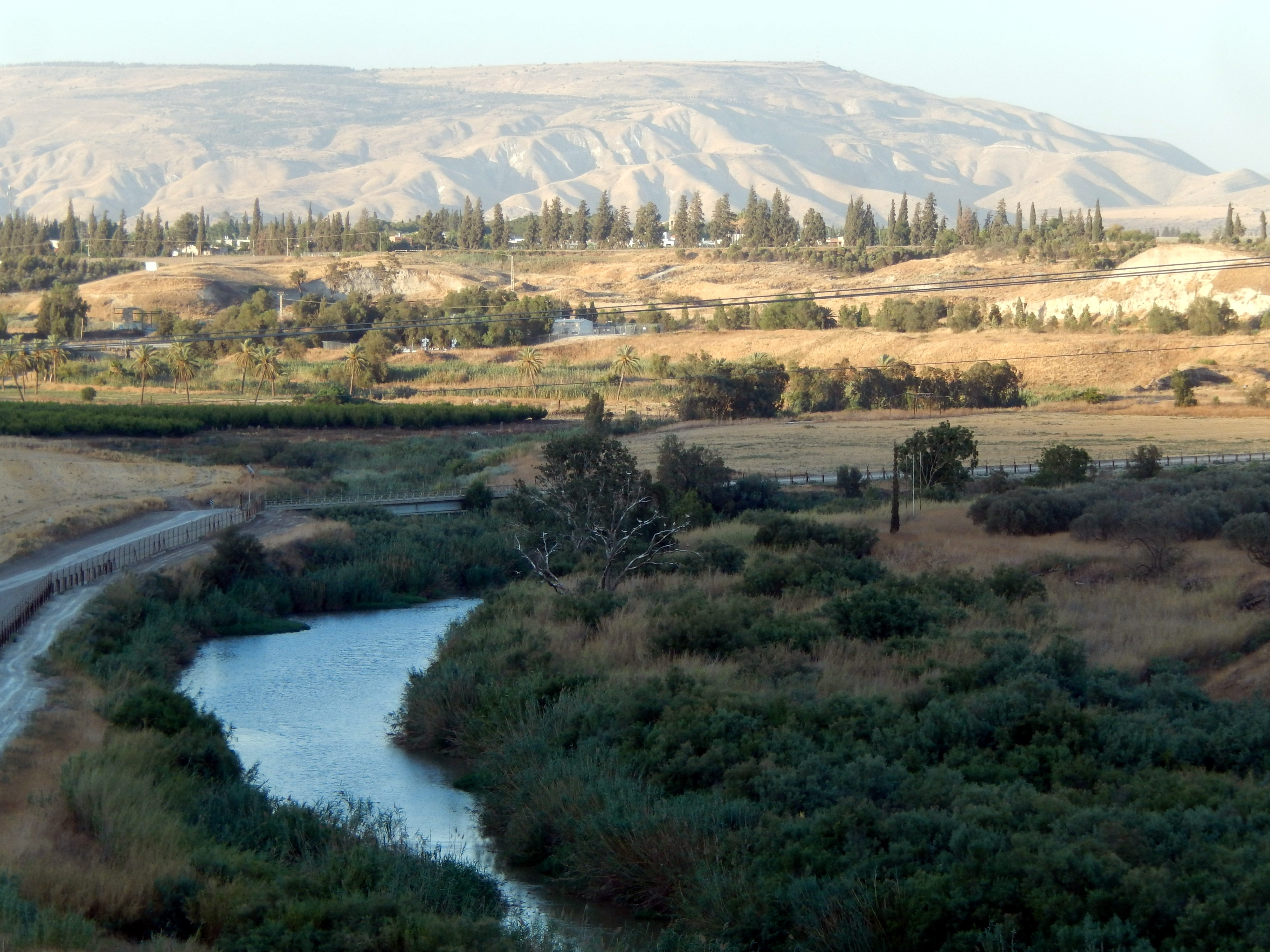 The Jordan river and in the background, the Gilead mountains in Jordan