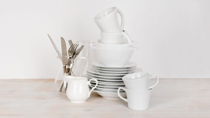 dishes stacked on wood counter