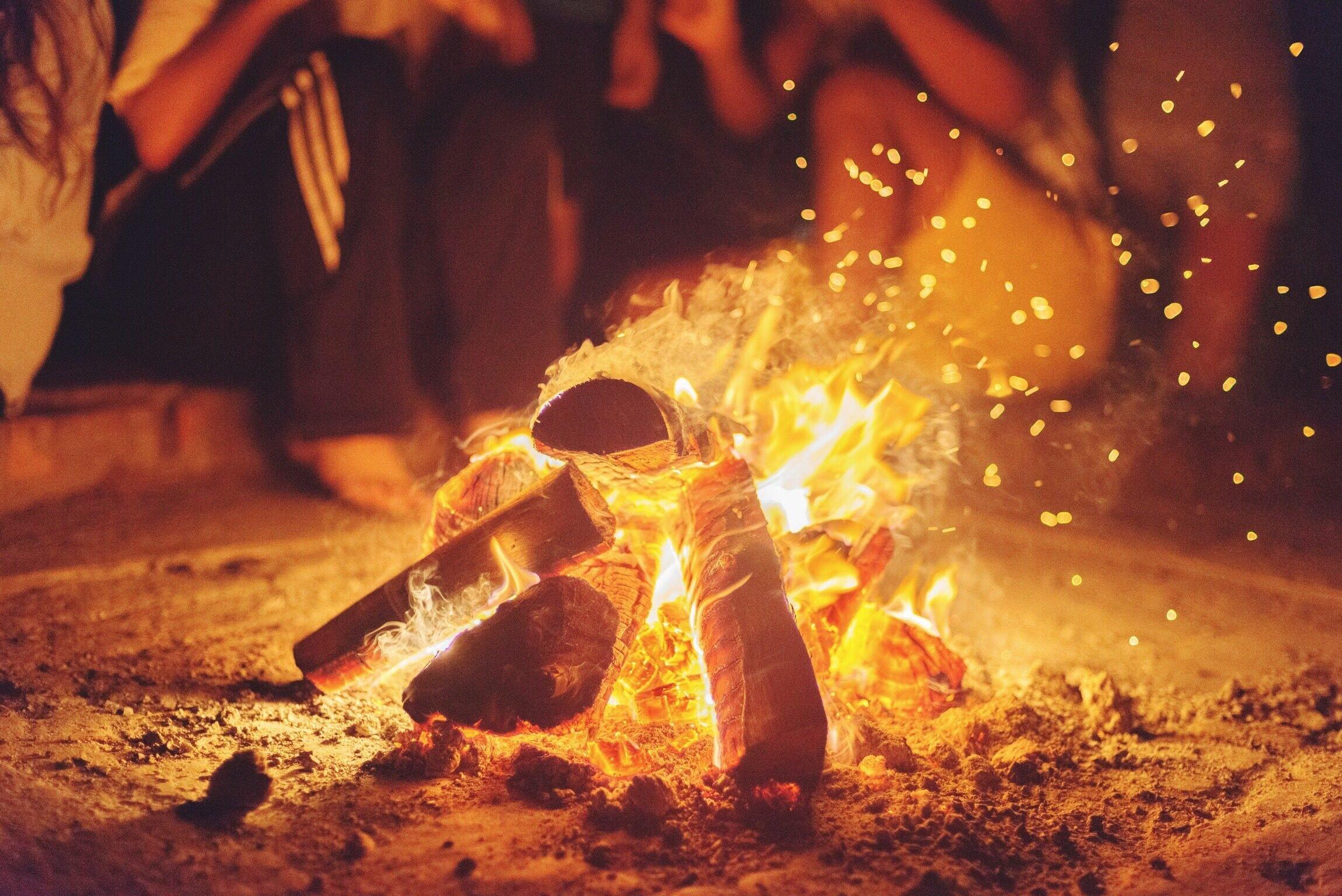 Wood Burning On Field At Night