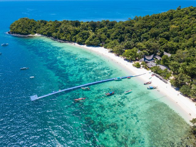 Aerial view or top view of tropical island beach with clear water at Banana beach