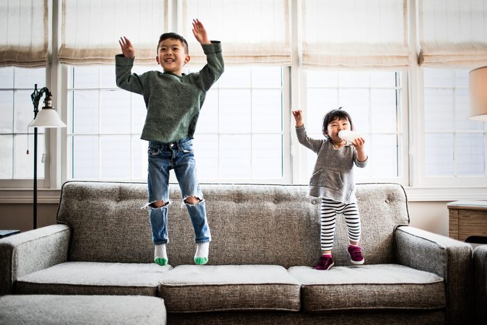 kids jumping on couch at home