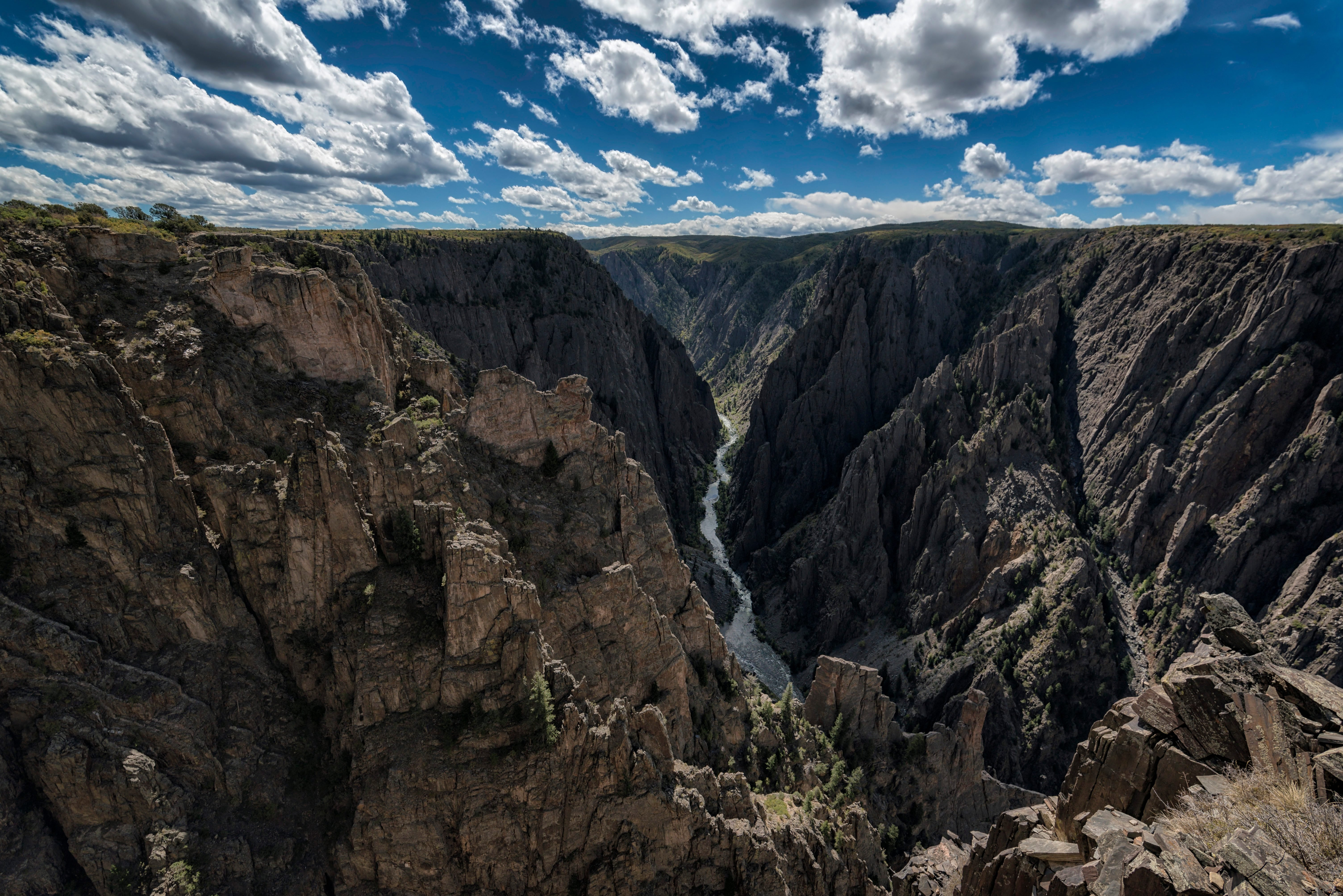 Gunnison river passing through canyons against sky