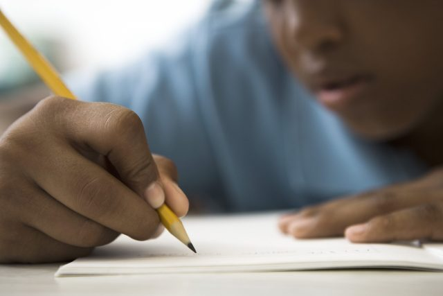 Student concentrating on classwork
