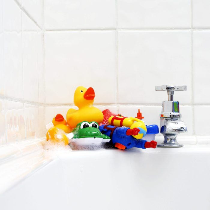 Bath tub with pile of toys