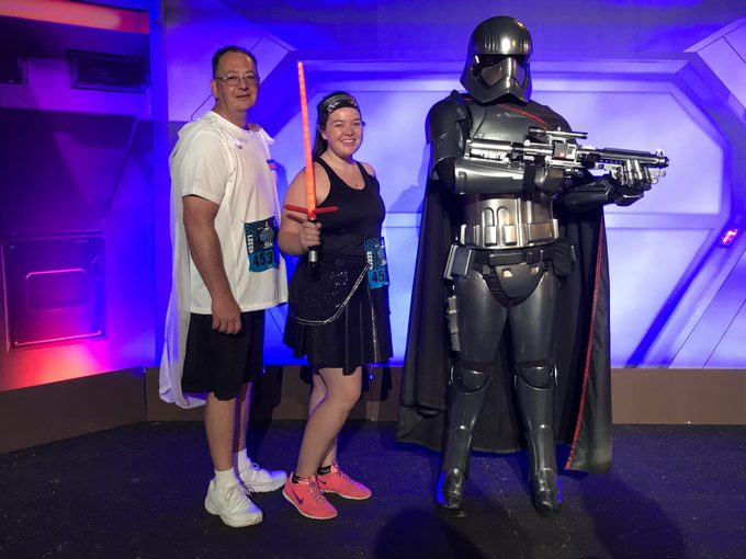 megan dubois and her dad pose next to a star wars character at the 5k race