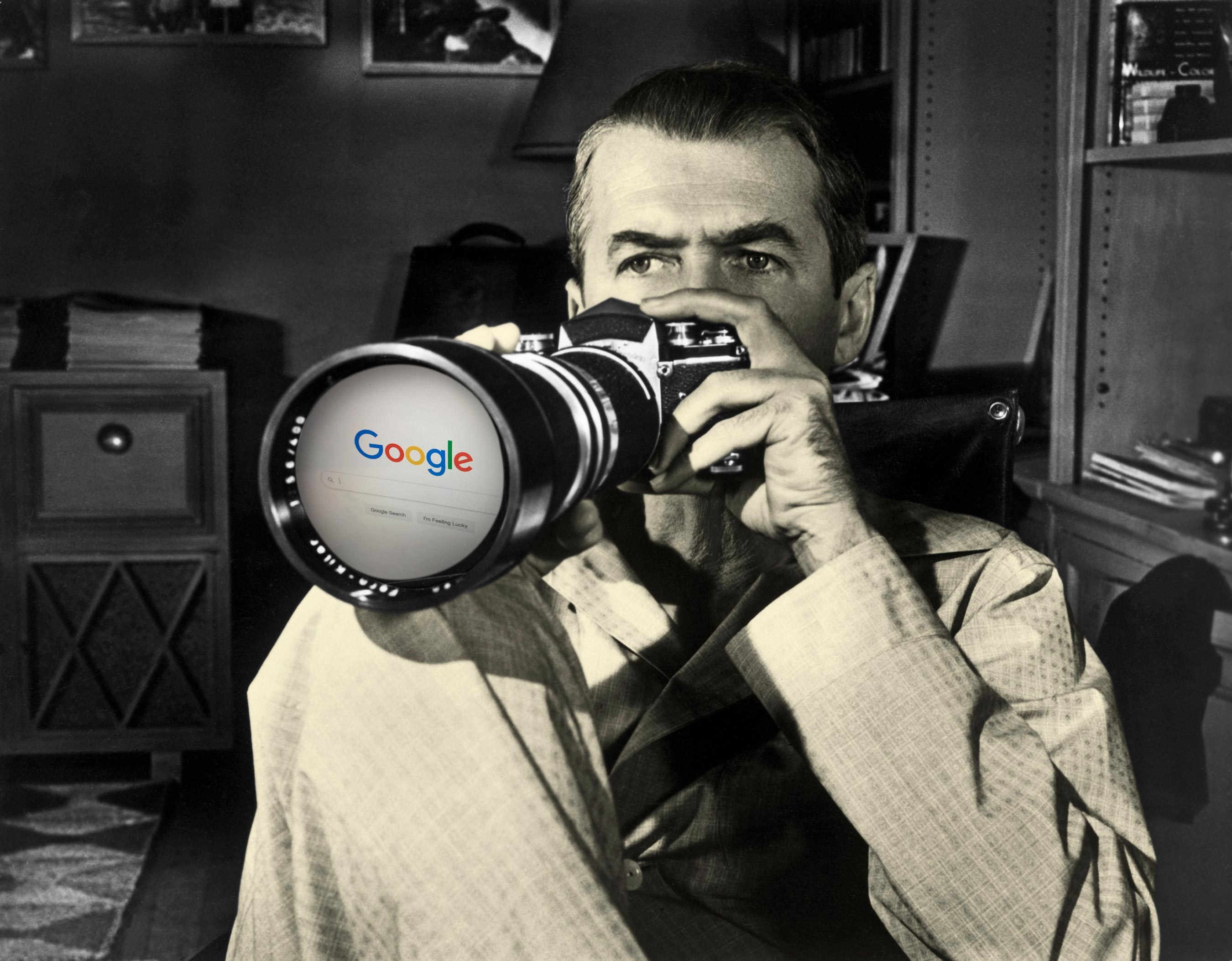 rear window movie still with google homepage in camera lens