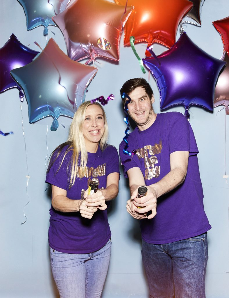 Mary Davis and Ari Kadin with party poppers and balloons