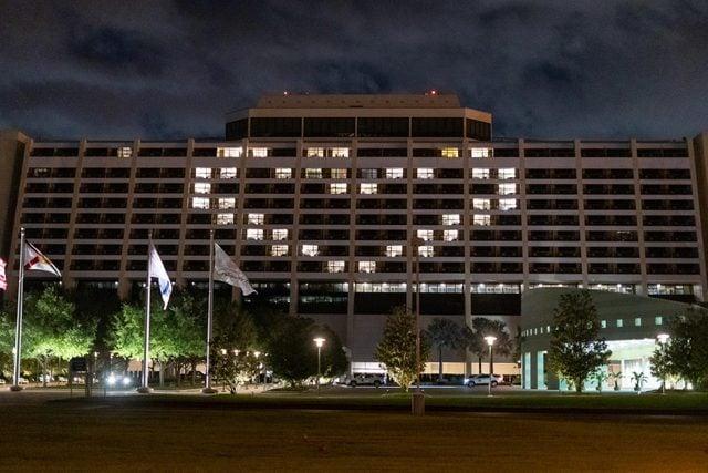 resort hotel windows lit up to make a heart