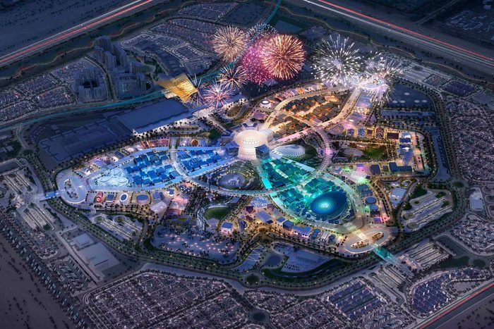 nighttime aerial view of the world expo at dubai