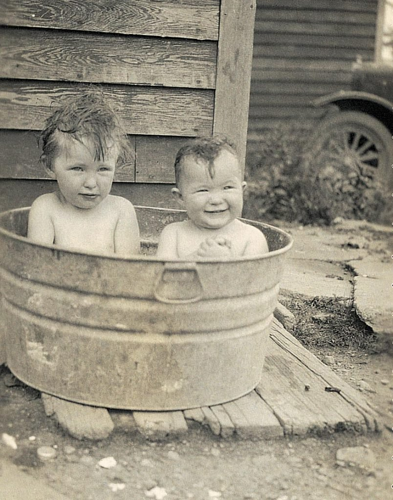 two kids in a tub