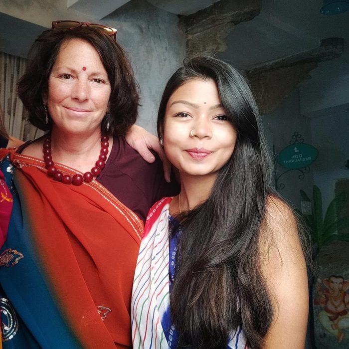 two women dressed in saris