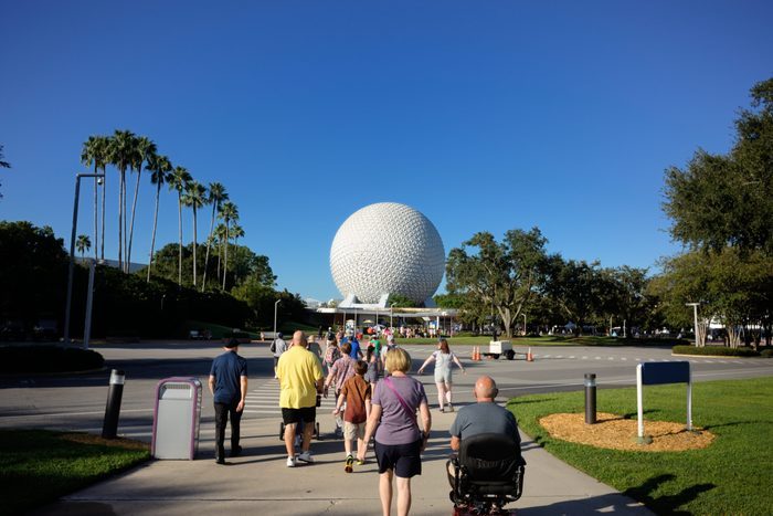 Tourists walking toward Epcot entrance