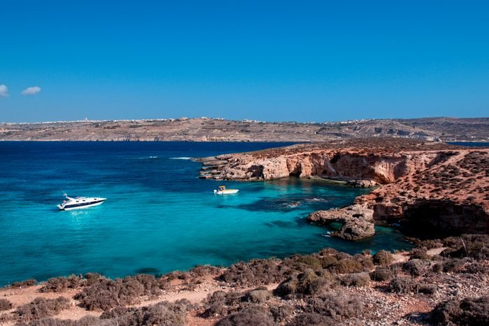 Boats anchored in Blue Lagoon, Comino Island, Gozo, Malta