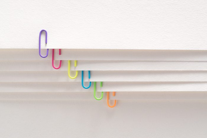Paperclips on Layered Paper Page