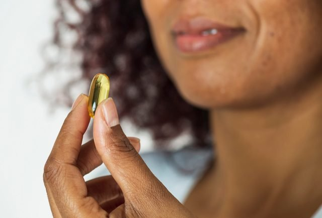 African Woman Showing Pill