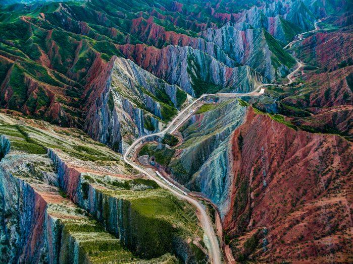 Aerial view of road through Danxia landform, Xinjiang, China