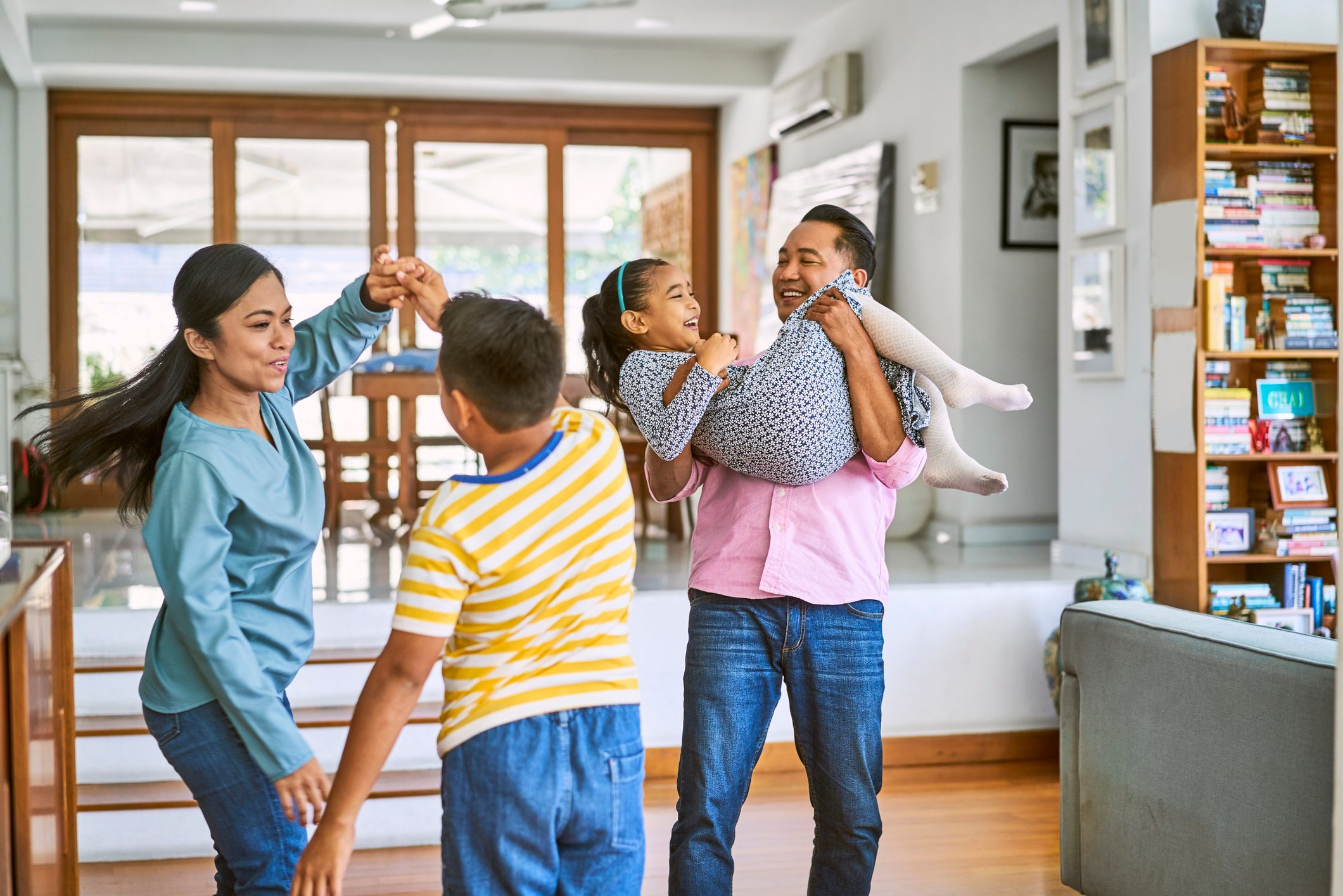 Happy family enjoying while dancing at home